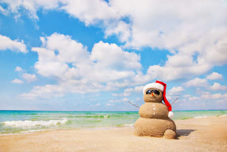 Sandy snowman. Holiday concept can be used for New Year's and Christmas Cards