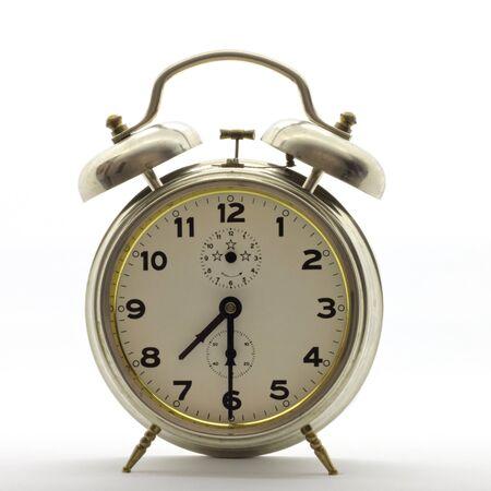 Foto de Old-style alarm clock, metal, it's half past seven. - Imagen libre de derechos
