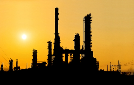 Oil refinery silhouette at sunset.