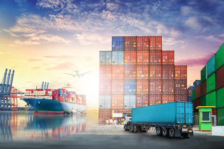 Foto de Logistics import export background and transport industry of Container truck and Cargo ship in seaport at sunset sky - Imagen libre de derechos