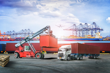 Photo pour Logistics import export background and transport industry of forklift handling container box loading at seaport - image libre de droit