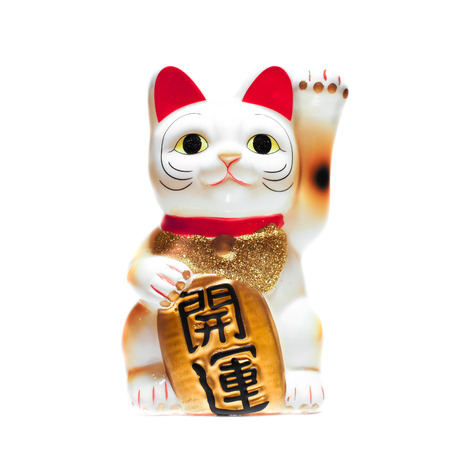 Japanese Lucky Cat isolated on White Background, tri-colors cat, the Japanese Text kai-unn translated as badluck goes away, success and fortune come in.