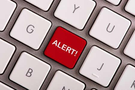 Alert button on white computer keyboard