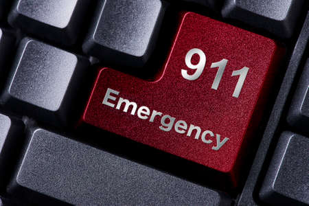 close up red enter button written emergency