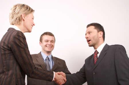 Group of  3 busisness people - man and woman hand shake