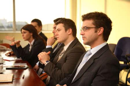 Photo pour Five business people during formal meeting - image libre de droit