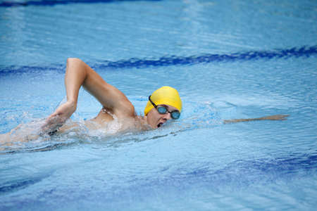 Swimmer in yellow cup breathing during front crawl