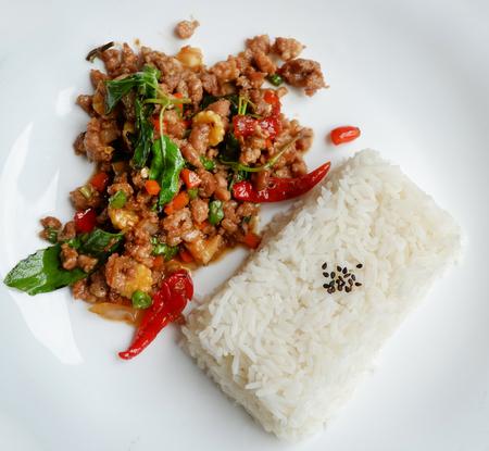 Stir fried pork basil top view / Thai Style spicy food holy basil pork fried rice recipe (Phat Kra Pow Moo)