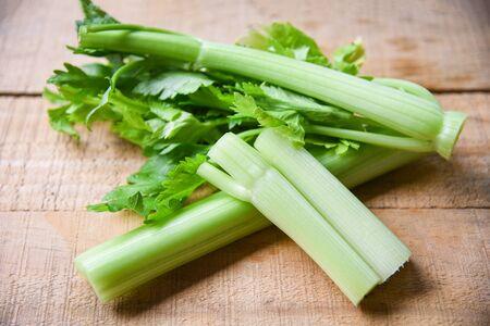 Foto für Celery sticks and leaf fresh vegetable / Bunch of celery stalk on wooden background - Lizenzfreies Bild