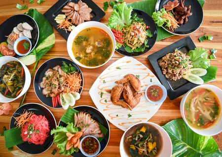 Photo pour Thai food served on dining table / Tradition northeast food Isaan delicious on plate with fresh vegetables - Many variety various Thai menu Asian food on a wooden table, top view - image libre de droit