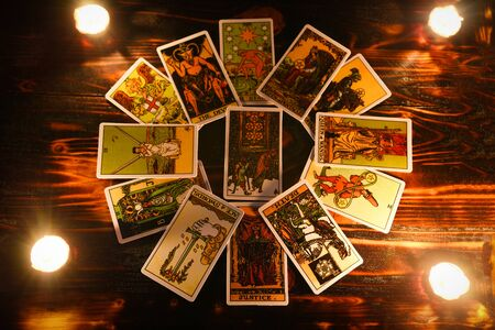 Foto de tarot cards for tarot readings psychic as well as divination with candle light / fortune teller reading future or former and present - Imagen libre de derechos