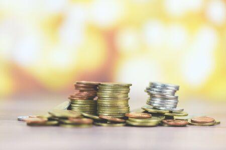 Foto de Coins on table / Pile of Golden coin, silver coin and copper coin on wooden money financial concept - Imagen libre de derechos