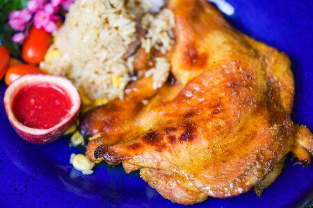 Photo pour Grilled chicken Tabaka with red sauce and fried rice on plate asian food in thai / roast chicken - image libre de droit
