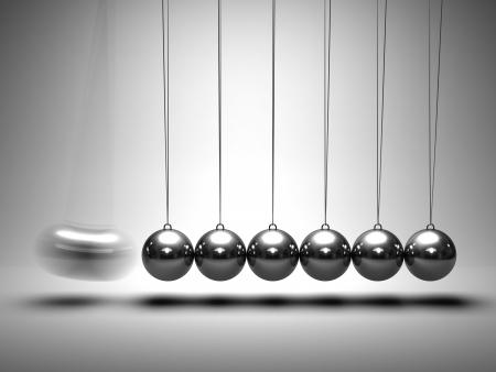 Balancing balls Newton's cradle on grey background