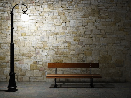 Photo pour Night view of the illuminated brick wall with old fashioned street light and bench - image libre de droit