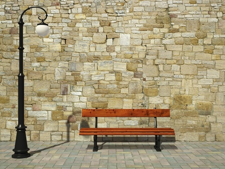 Brick wall with old fashioned street light and bench
