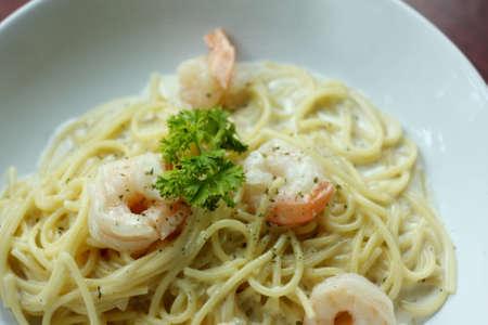 spaghetti with shrimp and white cream sauce.