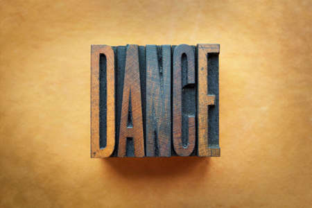 The word DANCE written in vintage letterpress type.