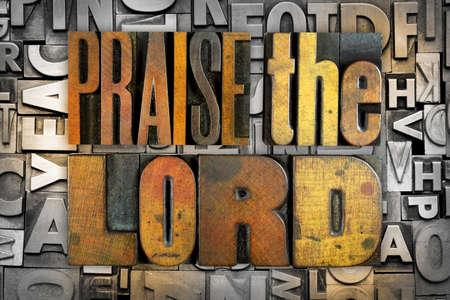 The words PRAISE THE LORD written in vintage letterpress type