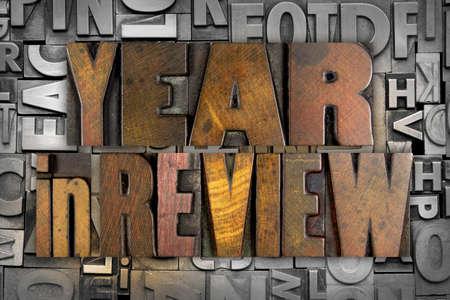 The words YEAR IN REVIEW written in vintage letterpress type