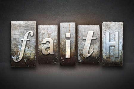 The word FAITH written in vintage letterpress type