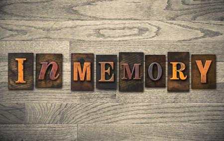 The words IN MEMORY written in vintage wooden letterpress type.