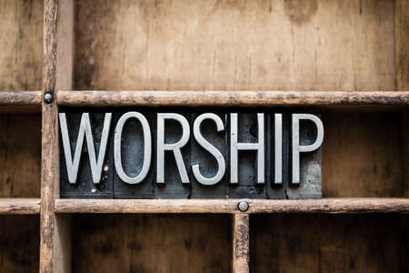 Photo for The word WORSHIP written in vintage metal letterpress type in a wooden drawer with dividers. - Royalty Free Image