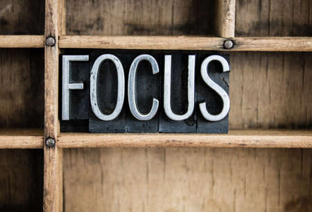 Photo for The word FOCUS written in vintage metal letterpress type in a wooden drawer with dividers. - Royalty Free Image