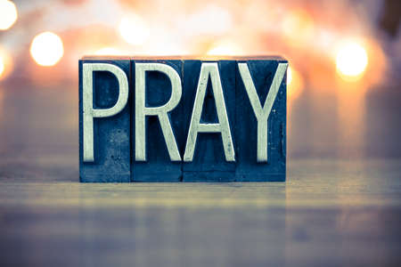 Photo for The word PRAY written in vintage metal letterpress type on a soft backlit background. - Royalty Free Image