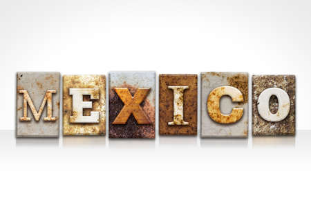 The word MEXICO written in rusty metal letterpress type isolated on a white background.