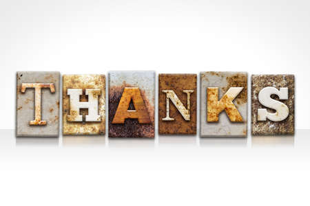 The word THANKS written in rusty metal letterpress type isolated on a white background.