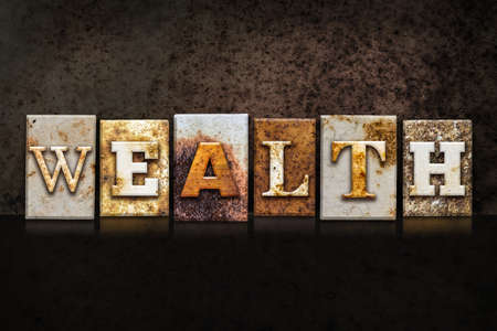 The word WEALTH written in rusty metal letterpress type on a dark textured grunge background.