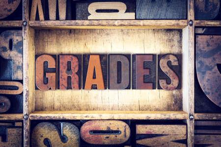 The word Grades written in vintage wooden letterpress type.