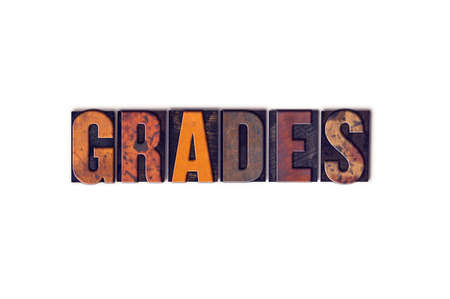 The word Grades written in isolated vintage wooden letterpress type on a white background.