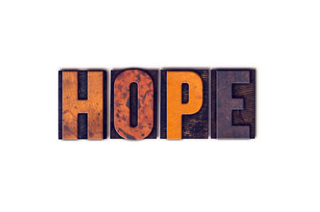 Photo pour The word Hope written in isolated vintage wooden letterpress type on a white background. - image libre de droit