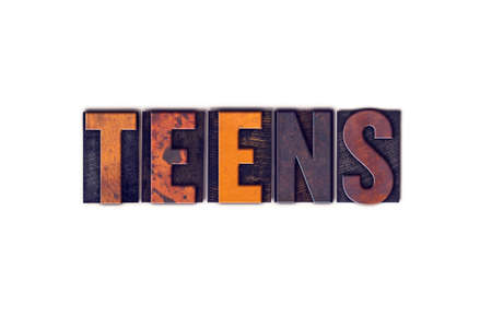 The word Teens written in isolated vintage wooden letterpress type on a white background.