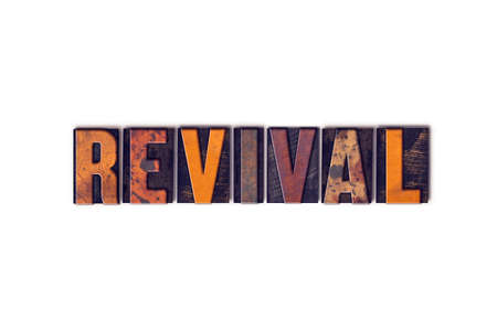 The word Revival written in isolated vintage wooden letterpress type on a white background.