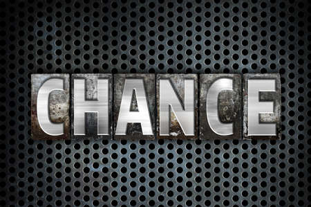 The word Chance written in vintage metal letterpress type on a black industrial grid background.