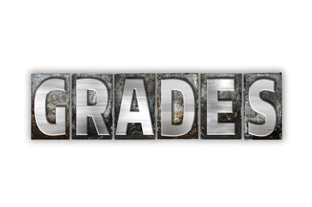 The word Grades written in vintage metal letterpress type isolated on a white background.