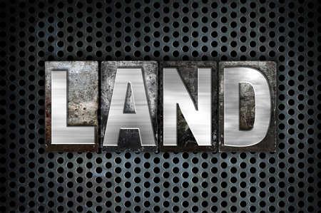 The word Land written in vintage metal letterpress type on a black industrial grid background.