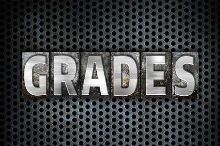 The word Grades written in vintage metal letterpress type on a black industrial grid background.