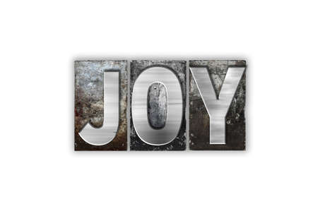 The word Joy written in vintage metal letterpress type isolated on a white background.
