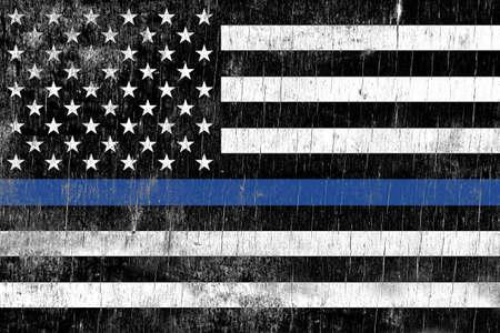 Foto de A law enforcement police support flag painted over a cracking wooden texture. - Imagen libre de derechos