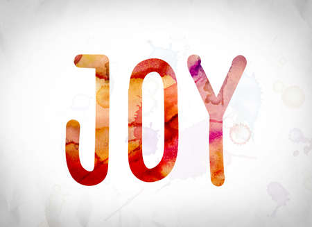 The word Joy written in watercolor washes over a white paper background concept and theme.