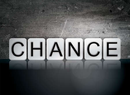 The word Chance written in white tiles against a dark vintage grunge background.