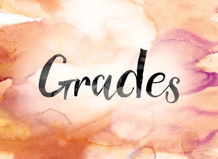 The word Grades painted in black ink over a colorful watercolor washed background concept and theme.