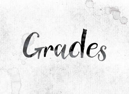 The word Grades concept and theme painted in watercolor ink on a white paper.
