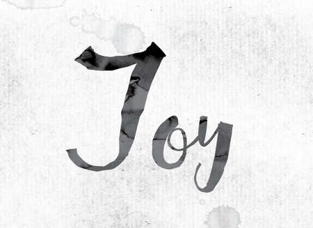 The word Joy concept and theme painted in watercolor ink on a white paper.
