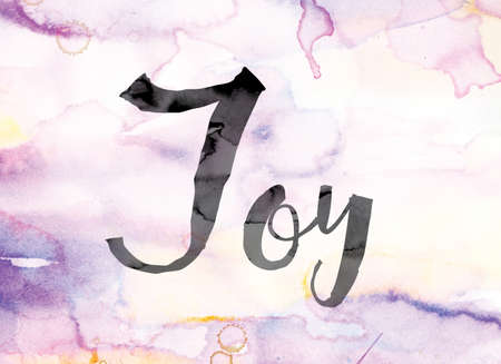 The word Joy painted in black ink over a colorful watercolor washed background concept and theme.