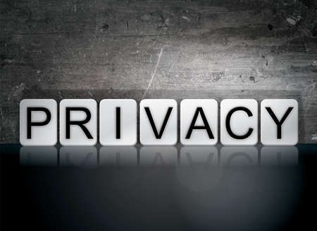 The word Privacy written in white tiles against a dark vintage grunge background.